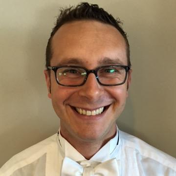 Kyle Rhoades, Artistic Director